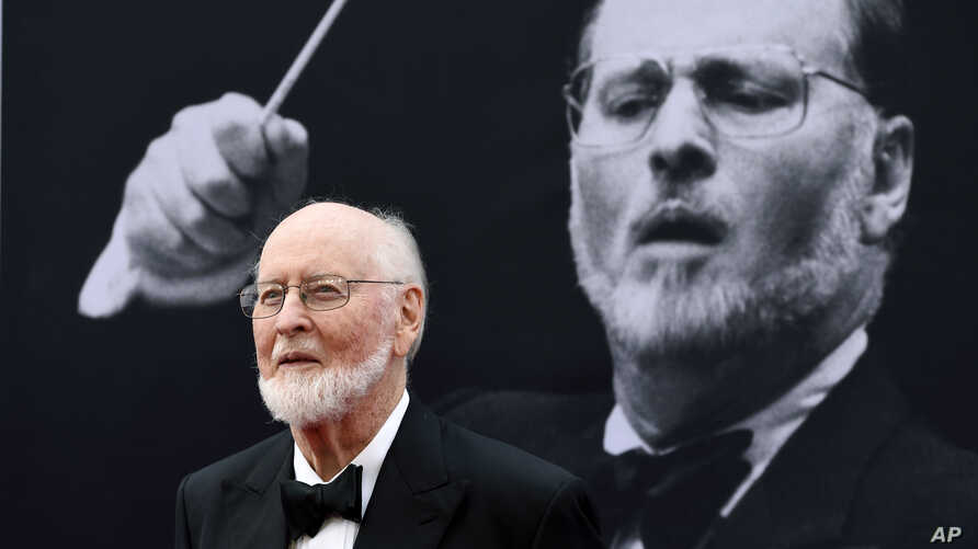 FILE - Composer John Williams poses on the red carpet at the 2016 AFI Life Achievement Award Gala Tribute to John Williams at the Dolby Theatre in Los Angeles, June 9, 2016.