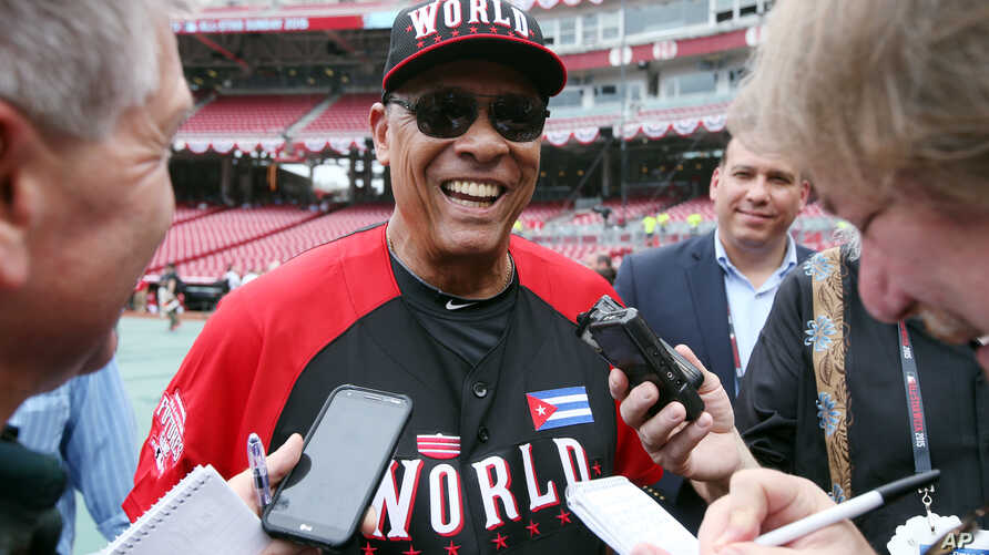Team World manager Tony Perez talks with the media during batting practice before the All-Star Futures baseball game against Team United States, in Cincinnati, July 12, 2015.
