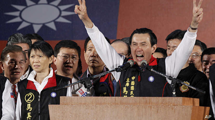 Taiwanese President Ma Ying-jeou declares his victory in the presidential election, Saturday, Jan. 14, 2012, in Taipei, Taiwan. Ma won a close re-election fight, leveraging his message of greater prosperity through expanded ties with China to beat hi