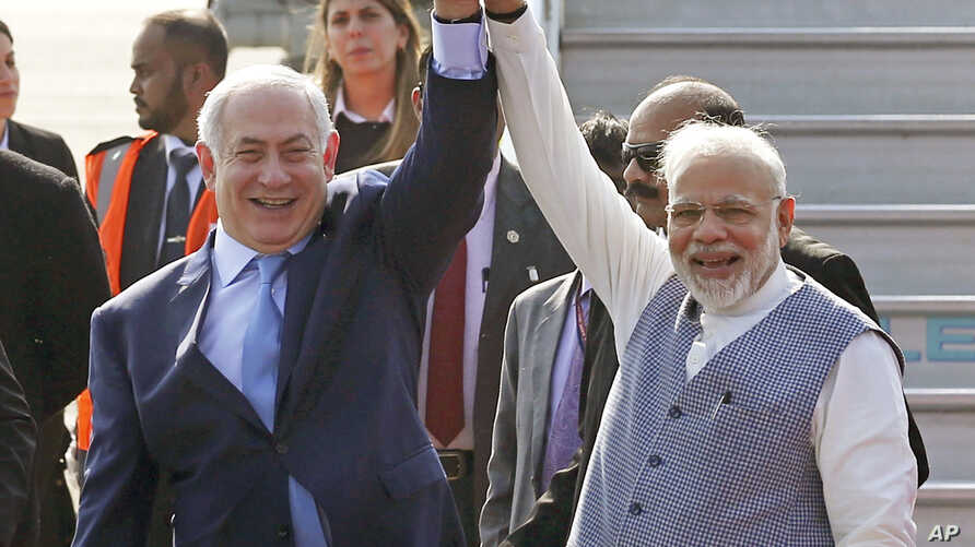 Israel's Prime Minister Benjamin Netanyahu, left, is welcomed by India's Prime Minister Narendra Modi on his arrival at Palam airport in New Delhi Sunday, Jan. 14, 2018.