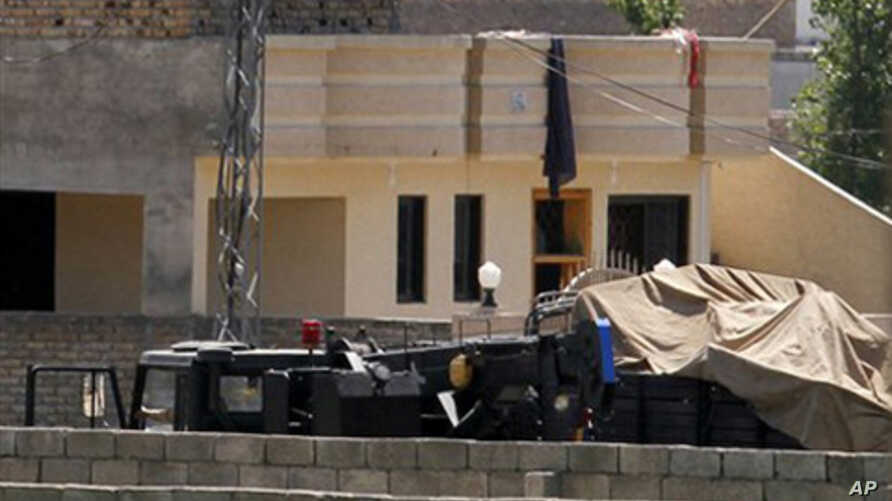 Vehicles parked inside the compound where Osama bin Laden lived in Abbottabad, Pakistan, May 2, 2011