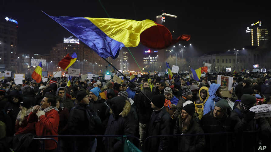 A protester waving a Romanian flag during a protest in Bucharest, Romania, Feb. 2, 2017.