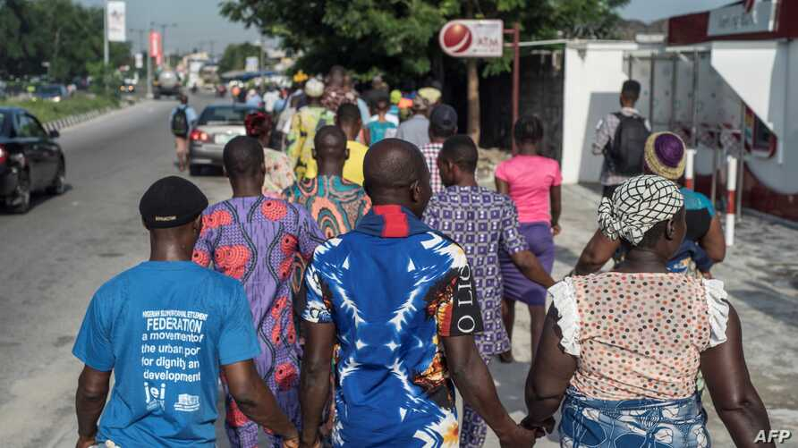 People march in the streets of Lagos as part of the National Day of Mourning, aiming at commemorating all the lives lost to violent killings and mass displacement in the country, on May 28, 2018.