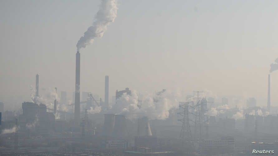 Smog billows from chimneys and cooling towers of a steel plant during hazy    weather in Taiyuan, Shanxi province, China, Dec. 28, 2016.