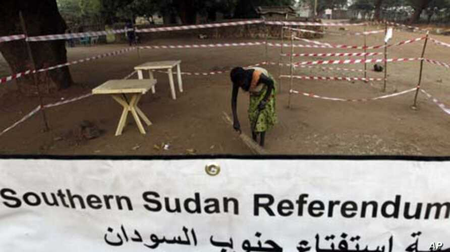 A worker sweeps a polling centre before the opening of the fifth day of the referendum in Juba, south Sudan January 13, 2011