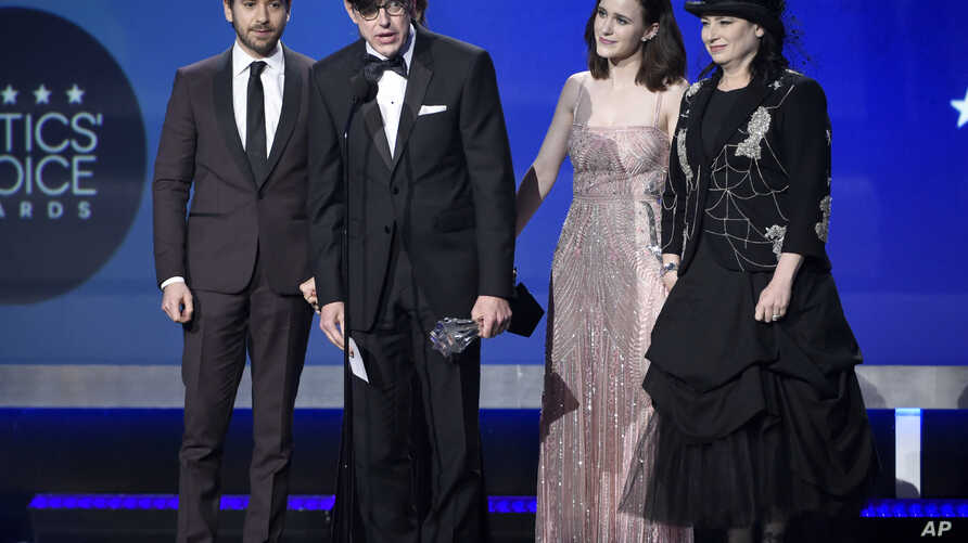 """Michael Zegen, from left, Daniel Palladino, Marin Hinkle, Rachel Brosnahan, and Amy Sherman-Palladino accepts the award for best comedy series for """"The Marvelous Mrs. Maisel"""" at the 23rd annual Critics' Choice Awards at the Barker Hangar on Thursday,"""