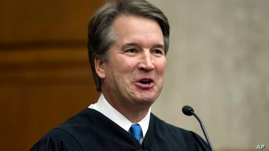 In this Aug. 7, 2018, photo. President Donald Trump's Supreme Court nominee, Judge Brett Kavanaugh, officiates at the swearing-in of Judge Britt Grant to take a seat on the U.S. Court of Appeals for the Eleventh Circuit in Atlanta at the U.S. Distric