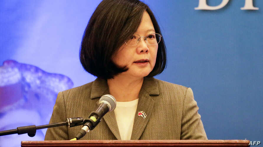 FILE - Taiwan's President Tsai Ing-wen delivers a speech during a meeting with businessmen from Nicaragua and Taiwan in Managua, Jan. 10, 2017.