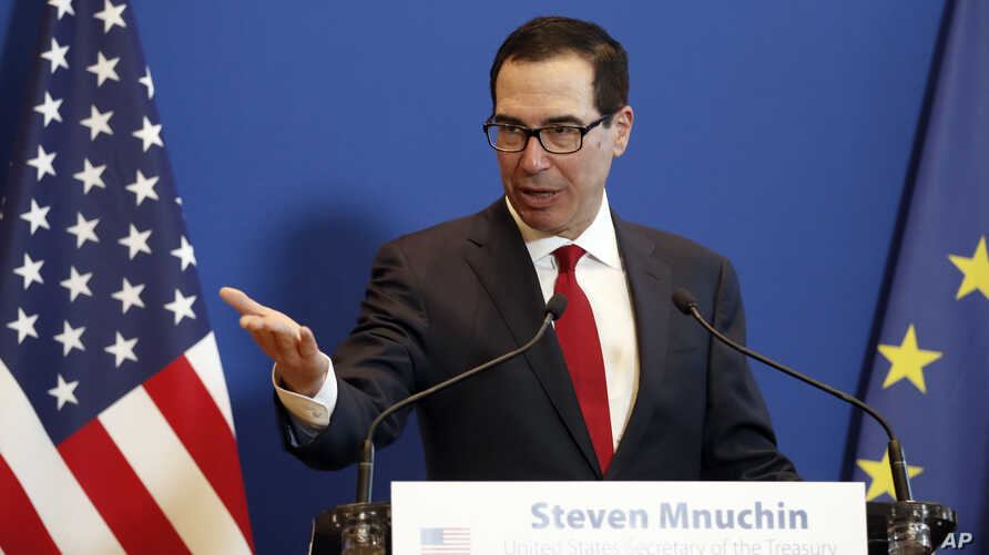 FILE - U.S. Treasury Secretary Steven Mnuchin speaks during a news conference with France's Economy Minister Bruno Le Maire after a meeting in Paris, Feb. 27, 2019.