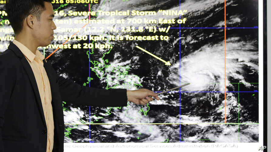 Weather specialist Benison Estareja shows the track of Tropical Storm Nock-Ten during a press conference in Quezon city, north of Manila, Philippines, Dec. 23, 2016.