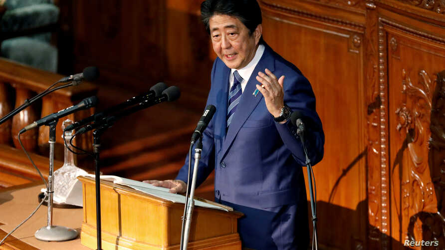 Japan's Prime Minister Shinzo Abe delivers his policy speech at the lower house of parliament in Tokyo, Oct. 24, 2018.