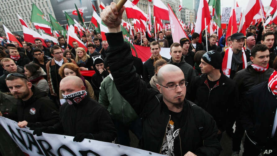 Right - wing protesters wave flags at the start of the Independence Day march organized by nationalist parties, in Warsaw, Poland, Nov. 11, 2014.