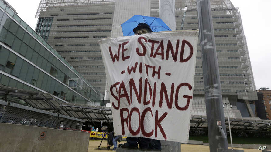 Opponents of the Dakota Access oil pipeline protest at the San Francisco Federal Building in San Francisco, Feb. 8, 2017.
