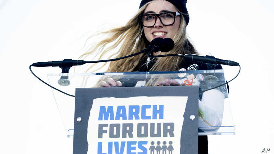 """Delaney Tarr, a survivor of the mass shooting at Marjory Stoneman Douglas High School in Parkland, Florida, speaks during the """"March for Our Lives"""" rally in support of gun control in Washington, March 24, 2018."""