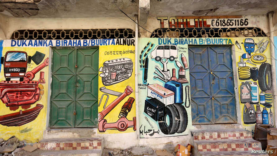 A mural showing spare parts for vehicles is seen on a wall of a shop in Hodan district of Mogadishu, Somalia, June 10, 2017.