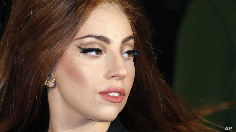 """Lady Gaga arrives for the UK launch of her new fragrance """"Fame"""" outside Harrods in London, Oct. 7, 2012."""