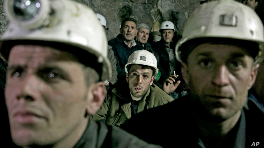Miners from the Trepca mining complex, sit during a strike, inside the Stari Trg mine, in Kosovo, Jan. 21, 2015.