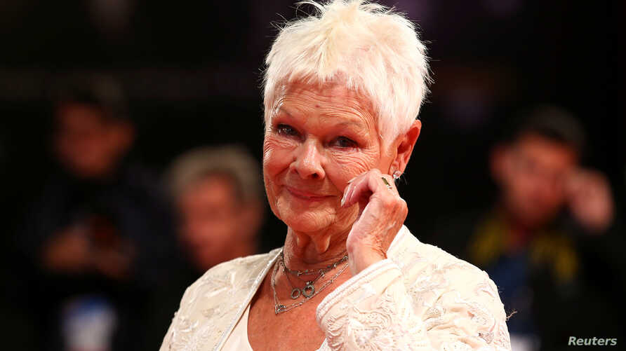 "Actor Judi Dench poses during a turn on the red carpet for the movie ""Victoria and Abdul"" at the 74th Venice Film Festival in Italy, Sept. 2017."