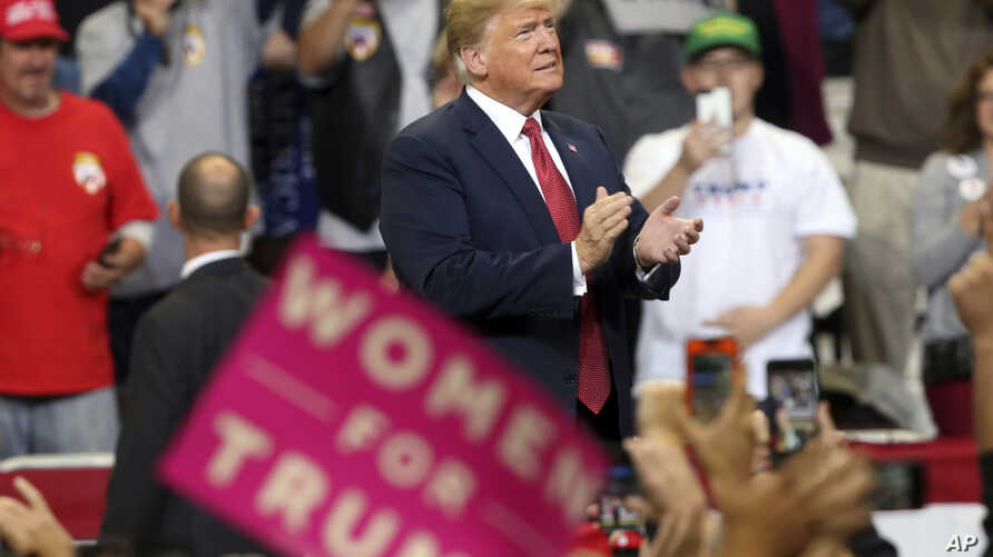 President Donald Trump arrives to speak at a campaign rally, Oct. 4, 2018, in Rochester, Minn.