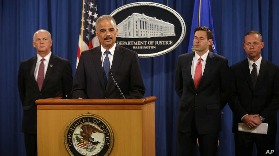 FILE: U.S. officials announced charges against five Chinese military officers at a Washington, D.C., news conference May 19, 2014. Attorney General Eric Holder, second from left, is joined by, from left, David Hickton, John Carlin and Robert Anderson