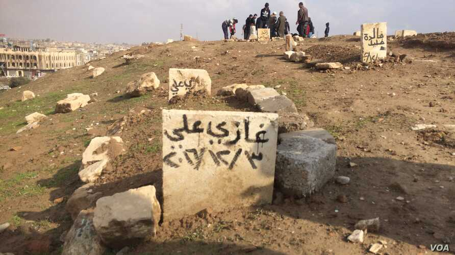 Islamic State militants told residents they destroyed gravestones because markers like this one, with the deceased's name and date of death (December 2016) is, in their opinion, against their religion, in Mosul, Iraq, Jan. 29, 2017. (H. Murdock/VOA)