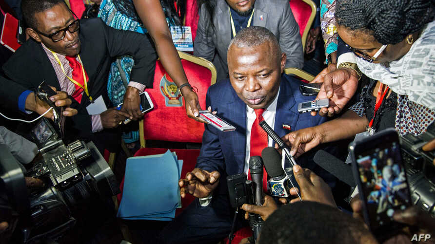 "Vital Kamerhe, President of the opposition Citizen Front Party (C) speaks to the media during the opening of a Congolese ""National Dialogue"" in the Democratic Republic of Congo's capital Kinshasa, Sept. 1, 2016."