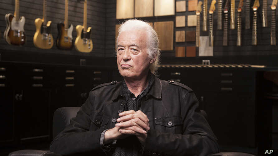Jimmy Page poses for a portrait at the Fender Factory in Corona, Calif., Oct. 10, 2018.
