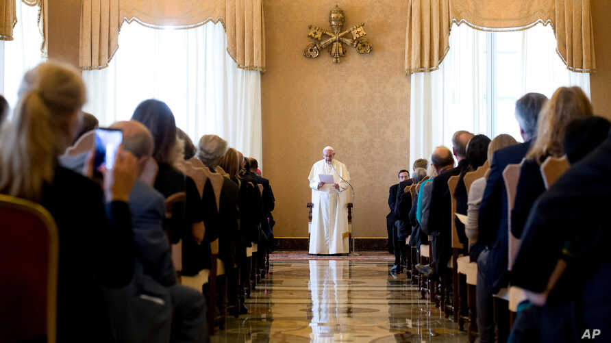 Pope Francis speaks to alumni of Jesuit schools in Europe, who were in Rome for a conference on refugees, at the Vatican, Sept. 17, 2016.
