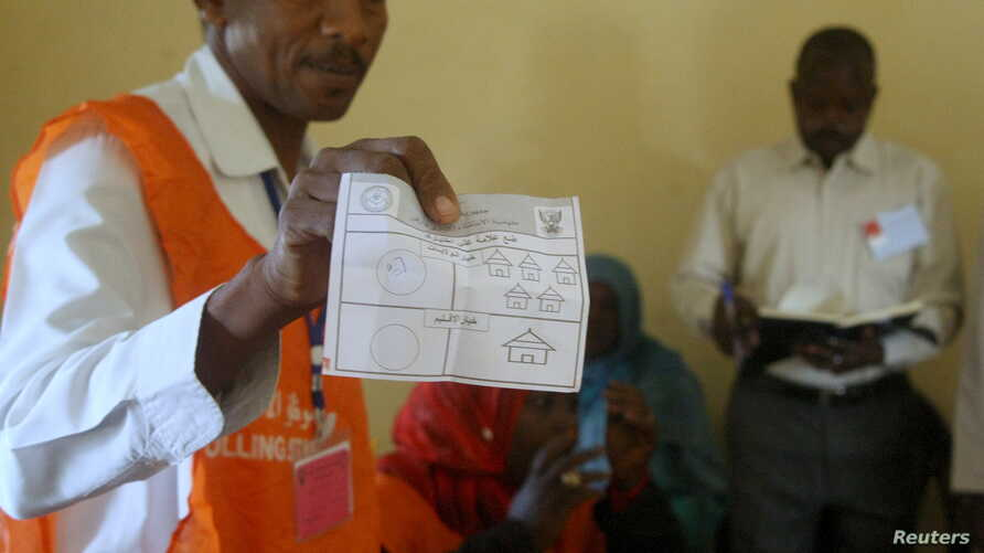 An official shows a ballot paper in after a referendum vote at El Fasher in North Darfur, April 14, 2016.