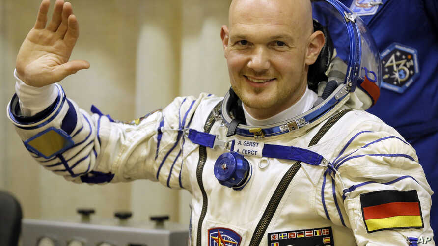FILE - European Space Agency's astronaut Alexander Gerst, crew member of the mission to the International Space Station, waves during inspection of his space suit prior to the launch of the Soyuz-FG rocket at the Russian-leased Baikonur cosmodrome, K