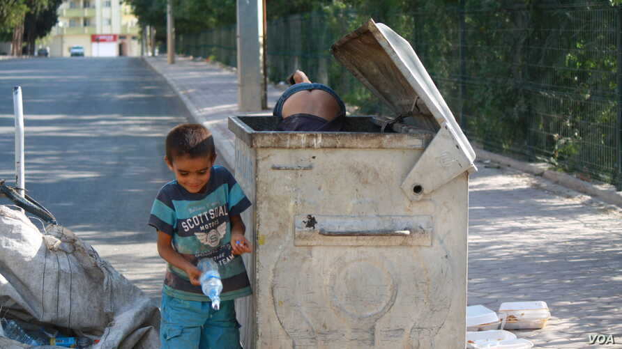 These young Syrian refugees couldn't talk long because they were hard at work near the Turkish border with Syria.  Collecting and selling trash together from 7 a.m. to 7 p.m., they can make, at most, $3 a day, Kilis, Turkey, Sept. 6, 2015. (Photo by