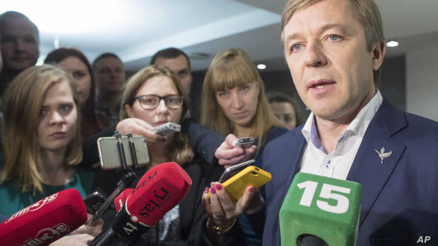 Lithuania's Peasant and Green's Union (LPGU) leader Ramunas Karbauskis speaks to the media after his party prevailed in the second round of voting in the country's parliamentary elections, in Vilnius, Lithuania, Oct. 23, 2016.