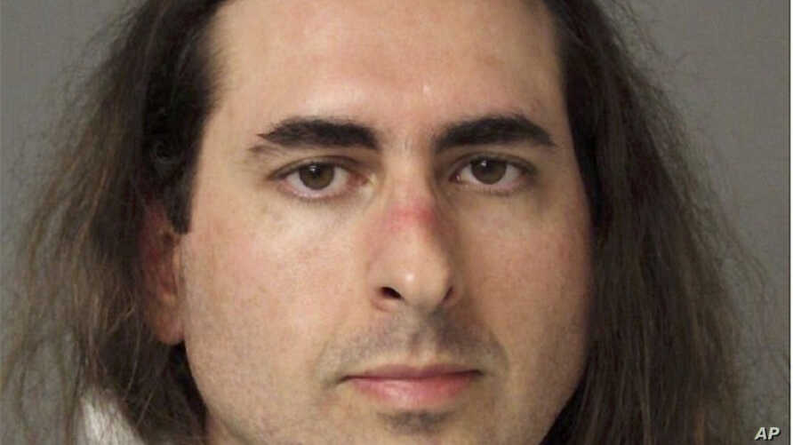 In this June 28 2018 photo released by the Anne Arundel Police, Jarrod Warren Ramos poses for a photo, in Annapolis, Maryland. First-degree murder charges were filed Friday against Ramos who police said targeted Maryland's capital newspaper, shooting...