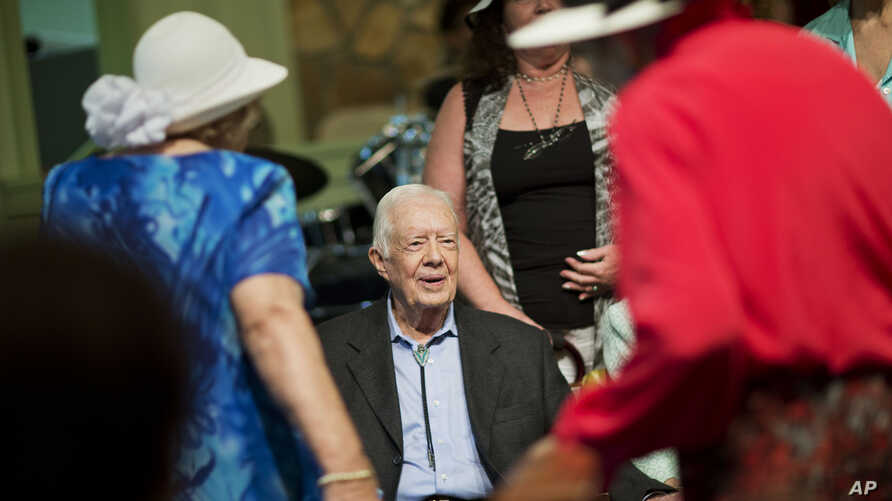 Former president Jimmy Carter, sits to pose for photos after teaching Sunday School class at Maranatha Baptist Church in his hometown Aug. 23, 2015, in Plains, Georgia.
