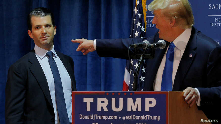 FILE - Then U.S. Republican presidential candidate Donald Trump welcomes his son Donald Trump Jr. to the stage at a campaign event in Manchester, New Hampshire November 11, 2015.