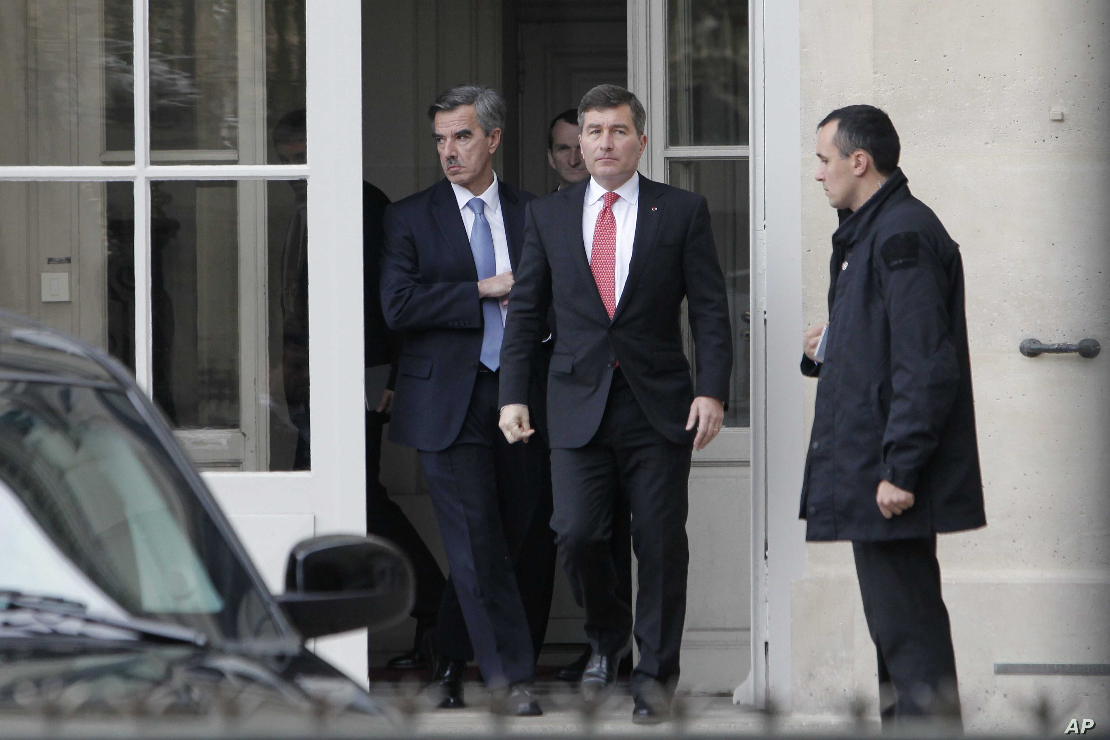 U.S Ambassador to France Charles Rivkin (right) leaves the Foreign Ministry in Paris, after he was summoned, Oct. 21, 2013, to explain why America spied on one of its closest allies.