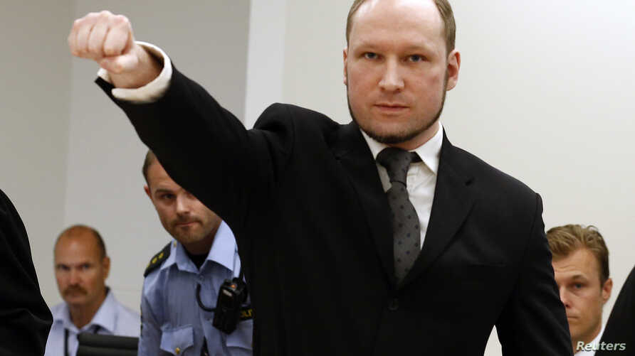 Norwegian mass killer Anders Behring Breivik gestures as he arrives at the court room in Oslo Courthouse August 24, 2012.