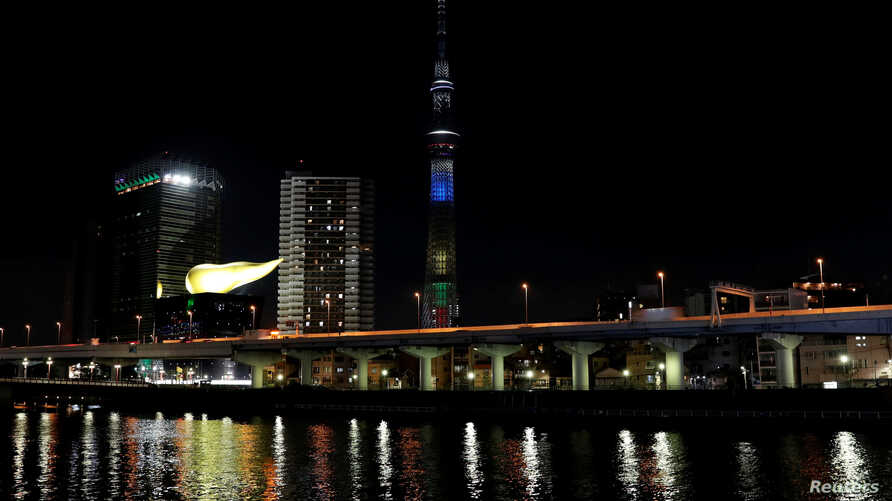 Tokyo Skytree is illuminated for a countdown to mark the two years until the opening of the Olympic Games Tokyo 2020 in Tokyo, Japan, July 24, 2018.