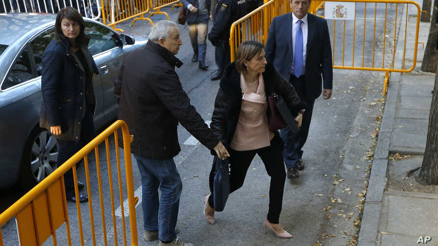 Ex-speaker of the Catalonia parliament Carme Forcadell , front right, arrives at the Spain's Supreme Court in Madrid, Nov. 9, 2017.