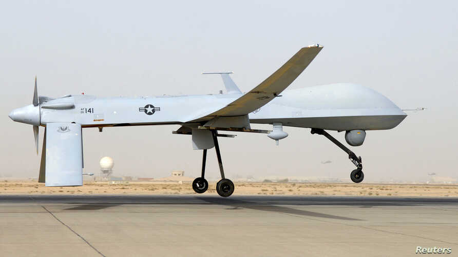 FILE - An MQ-1B Predator from the 46th Expeditionary Reconnaissance Squadron takes off from Balad Air Base in Iraq.