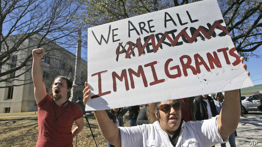 "Protesters chant outside the Grayson County courthouse in Sherman, Texas, Feb. 16, 2017. In an action called ""A Day Without Immigrants,"" immigrants across the country are expected to stay home from school, work and close businesses to show how critic"