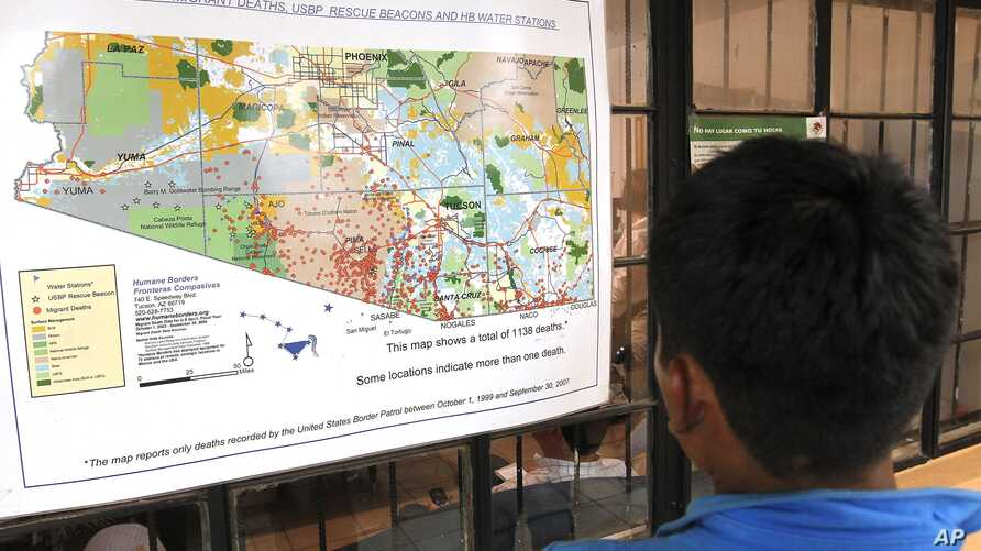 FILE - A young Mexican boy looks at a map of the recorded Arizona border deaths in a well-known immigrant shelter in Nogales, Mexico, Aug. 9, 2012.
