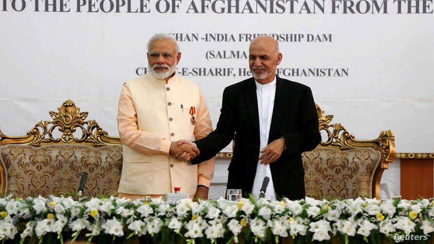 India's Prime Minister Narendra Modi (left) and Afghanistan's president Ashraf Ghani shake hands during the inauguration of the Salma Dam in Herat province, Afghanistan, June 4, 2016.