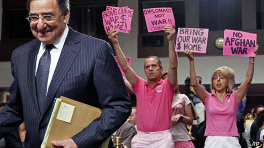 Protestors demonstrate as CIA Director Leon Panetta arrives to testify at his Senate confirmation hearings to become U.S. Secretary of Defense on Capitol Hill, Washington, June 9, 2011