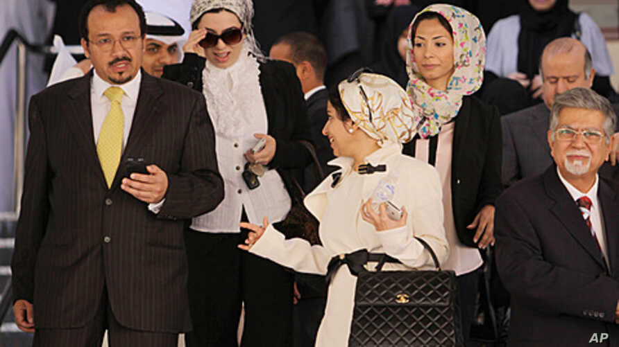 Dr. Ali al-Ekri, left, Dr. Nada Dhaif, center, Dr. Fatima Haji, 3rd right, and Dr. Saeed Samaheeji, right, leave the Manama, Bahrain, courthouse  after a trial session appealing security court convictions and sentences against them and other medics,