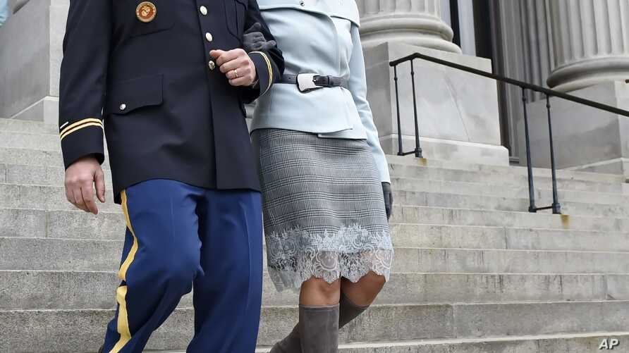 South Carolina Gov. Nikki Haley, seen in this Jan. 14, 2015 file photo, is escorted down the steps of the Capitol by her husband Michael, in Columbia, S.C. President-elect Donald Trump has chosen Haley as U.S. ambassador to the United Nations, the fi