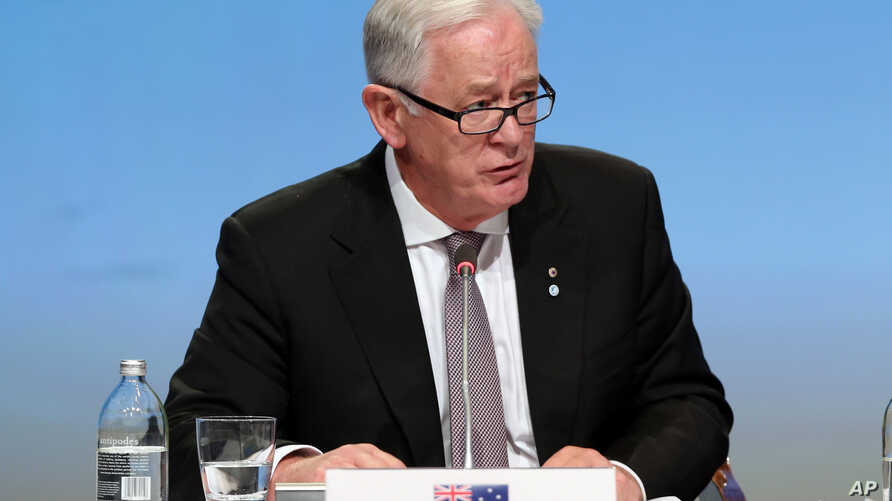 FILE - Australia's Minister for Trade and Investment Andrew Robb attends a press conference at the signing of the Trans-Pacific Partnership Agreement in Auckland, New Zealand, Feb. 4, 2016.
