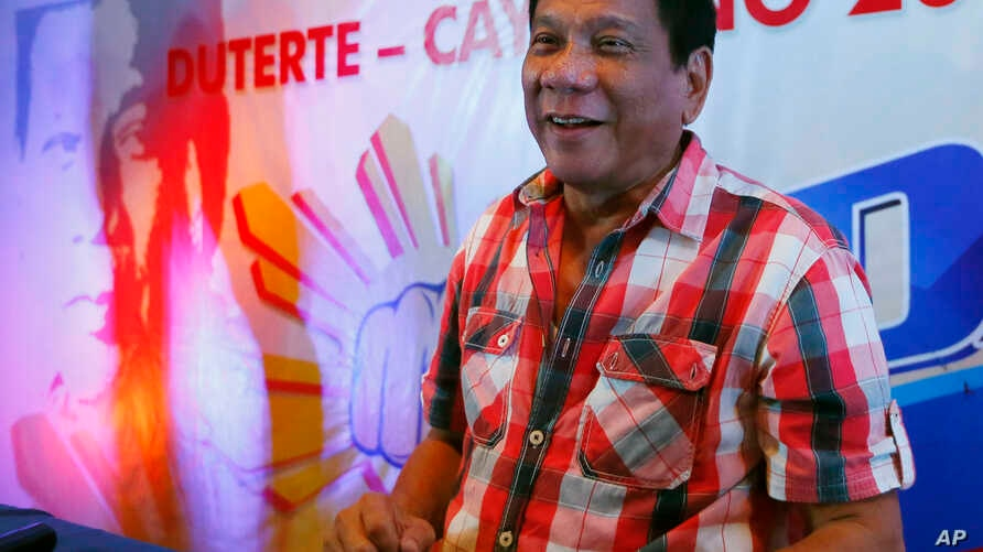 Front-running presidential candidate  Mayor Rodrigo Duterte smiles during a news conference shortly after voting in a polling precinct at Daniel R. Aguinaldo National High School, Matina district, his hometown in Davao city in southern Philippines ,