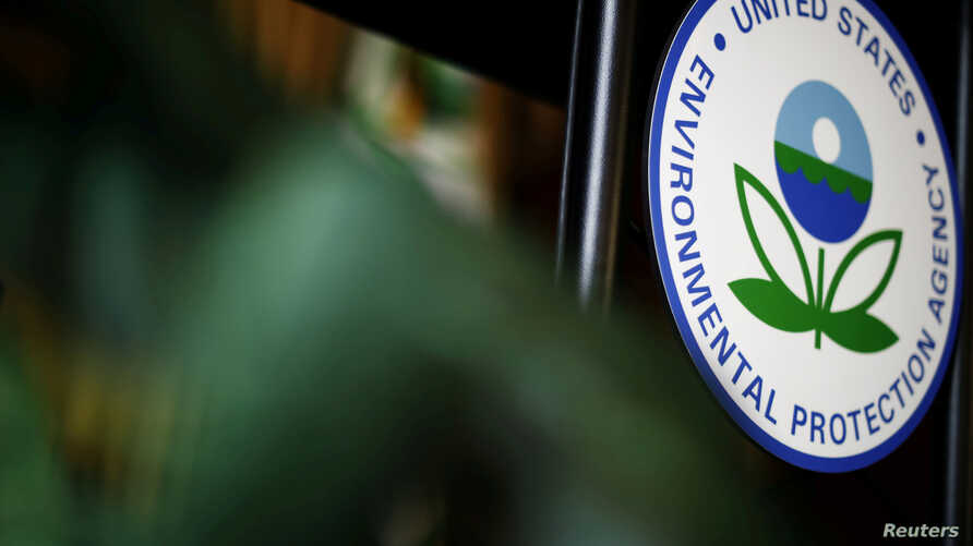 FILE - The U.S. Environmental Protection Agency (EPA) sign is seen on the podium at EPA headquarters in Washington, July 11, 2018.