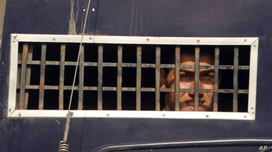 One of the convicted American Muslims looking out from a prison van in Sargodha, Pakistan (file photo)